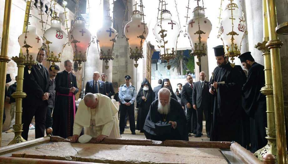 Pope Francis (left), worshipping at the Stone of Anointing at the Church of the Holy Sepulchre in Jerusalem, invited Israel's Shimon Peres and Mahmoud Abbas of the Palestinian Authority to the Vatican on June 6. Photo: GPO / Getty Images / 2014 GPO