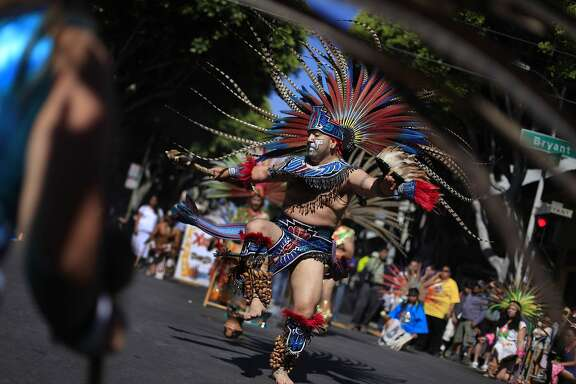 Xiuhcoatl Danza Azteca performs at  the start of the Carnaval parade on Sunday,  May 25, 2014 in San Francisco, Calif.