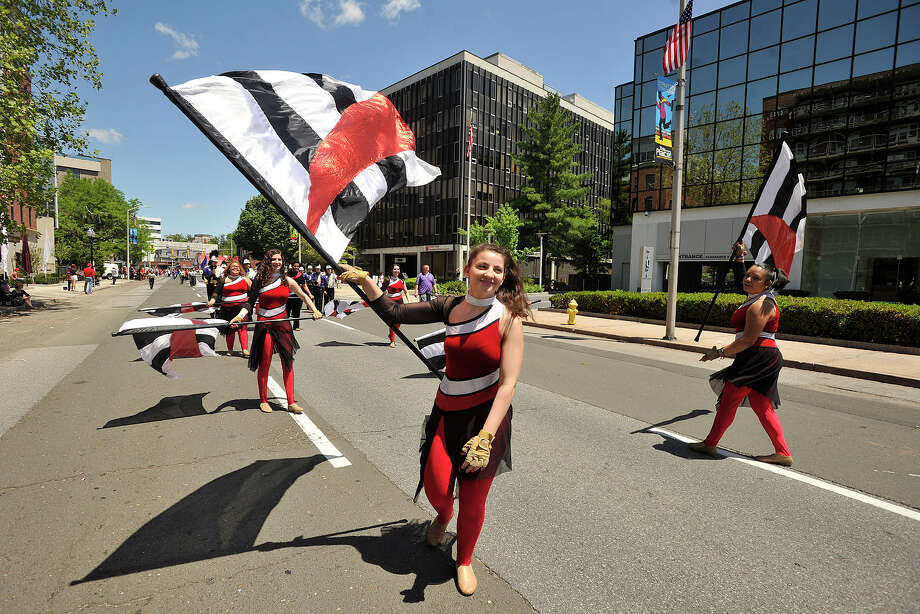 Whitney Cassell, with Westhill High School marching band flag corps, marches down Summer Street during the Memorial Day parade in downtown Stamford, Conn., on Sunday, May 25, 2014. Photo: Jason Rearick / Stamford Advocate