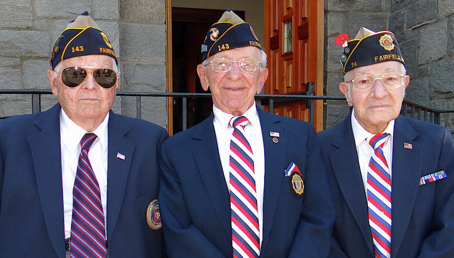 Military veterans Ed Crowley, Army; Peter Luzetsky, Marine Corps, and Alex Fucci, Army, at Our Lady of the Assumption's Memorial Day service Sunday. Photo: Mike Lauterborn / Fairfield Citizen