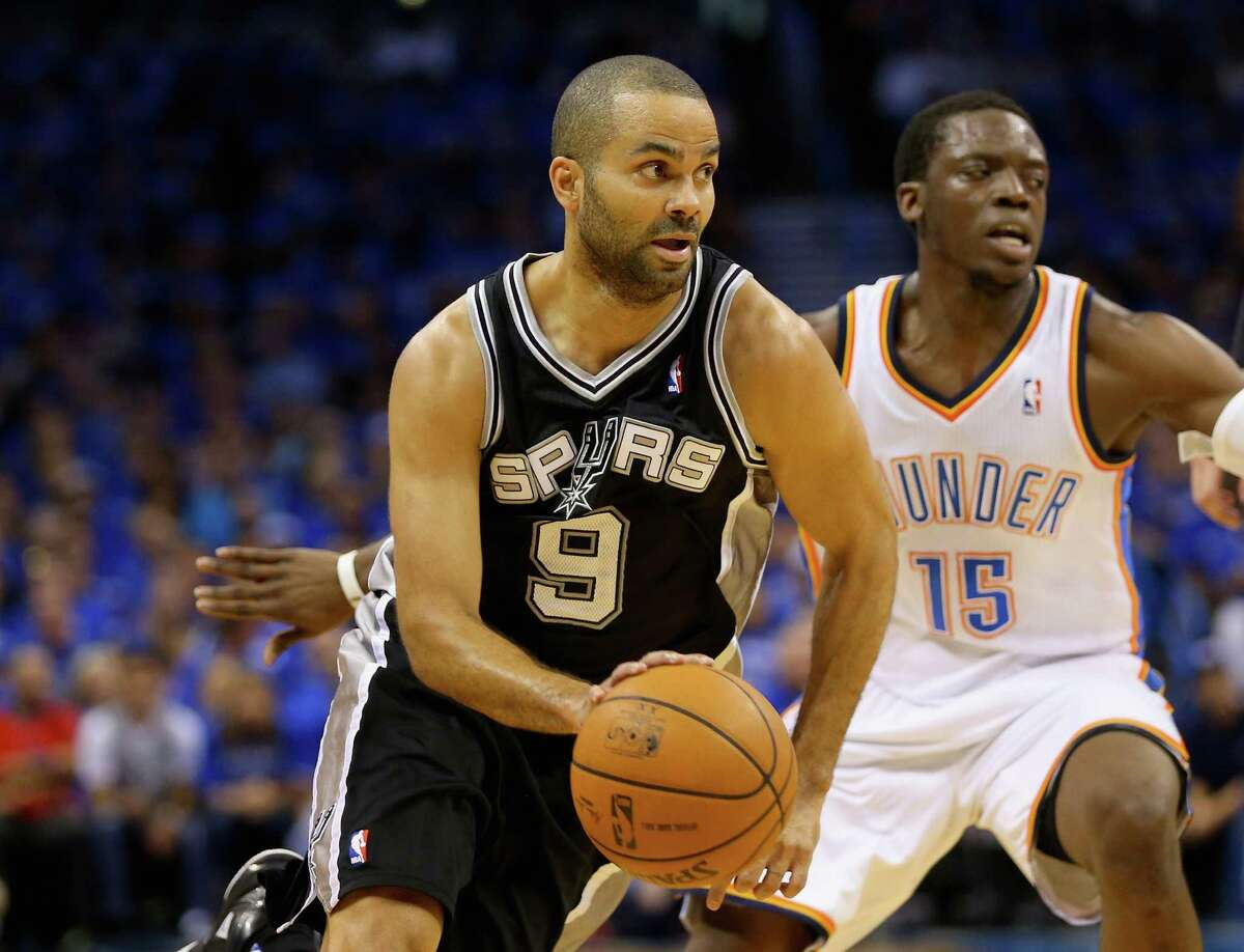 OKLAHOMA CITY, OK - MAY 25: Tony Parker #9 of the San Antonio Spurs handles the ball against Reggie Jackson #15 of the Oklahoma City Thunder in the first quarter during Game Three of the Western Conference Finals of the 2014 NBA Playoffs at Chesapeake Energy Arena on May 25, 2014 in Oklahoma City, Oklahoma.
