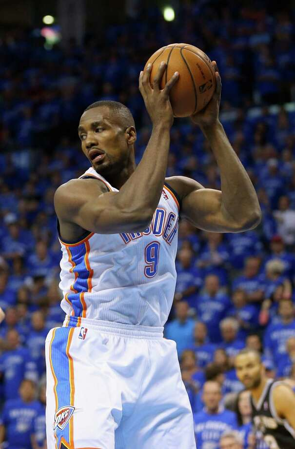OKLAHOMA CITY, OK - MAY 25: Serge Ibaka #9 of the Oklahoma City Thunder gets a rebound in the first quarter against the San Antonio Spurs during Game Three of the Western Conference Finals of the 2014 NBA Playoffs at Chesapeake Energy Arena on May 25, 2014 in Oklahoma City, Oklahoma. Photo: Ronald Martinez, . / 2014 Getty Images