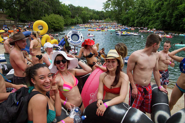 (Left to right) Tysha Lopez, Amber Perez and Kathryn Horvatitz ready for tubing on the Comal River in Prince Solms Park, Sunday, May 25, 2014 in celebration of Memorial Day. Lopez and Perez are in the Navy and Horvatitz is in the Air Force. Photo: Alma E. Hernandez,  For The Express-News