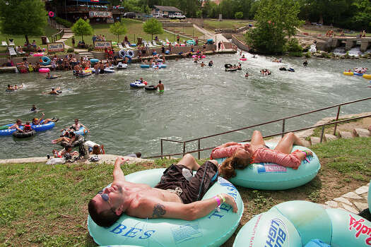 Tim Lewis and Myranda Ellis sunbathing after tubing on the Comal River, New Braunfels, Texas, Sunday, May 25, 2014. Photo: Alma E. Hernandez, Alma E. Hernandez, For The Express-News