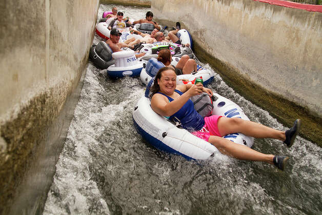 A large group coming through the tube chute at Prince Solms Park on the Comal River, New Braunfels, Texas, Sunday, May 25, 2014. Photo: Alma E. Hernandez,  For The Express-News