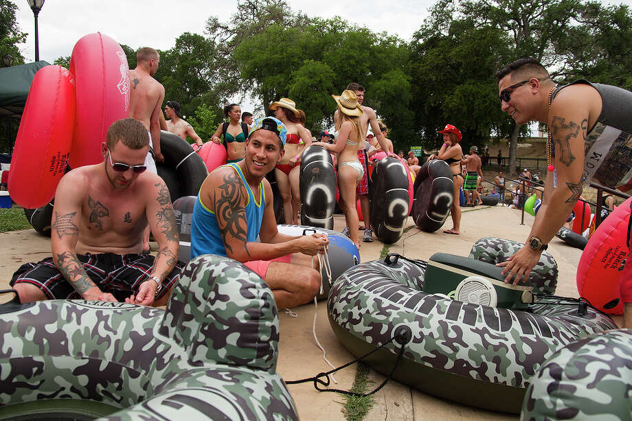 (Left to right) Will Harris, CJ Hernandez and Martin Hernandez, retired military men, celebrating Memorial Day weekend, Sunday, May 25, 2014 by tubing down the Comal River in New Braunfels, Texas. Photo: Alma E. Hernandez, Alma E. Hernandez, For The Express-News