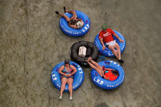 Tubing on the Comal River, New Braunfels, Texas, Sunday, May 25, 2014. Photo: Alma E. Hernandez, Alma E. Hernandez, For The Express-News