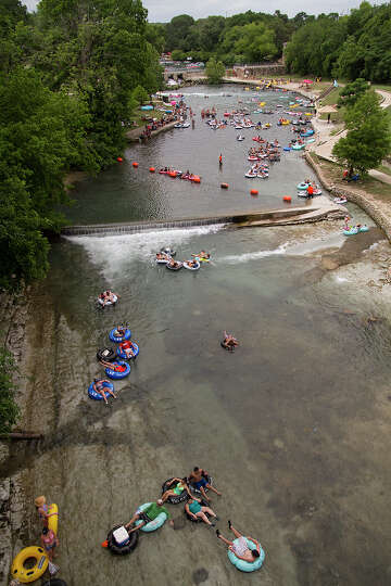 View of tubers on the Comal River, New Braunfels, Texas, Sunday, May 25, 2014.
