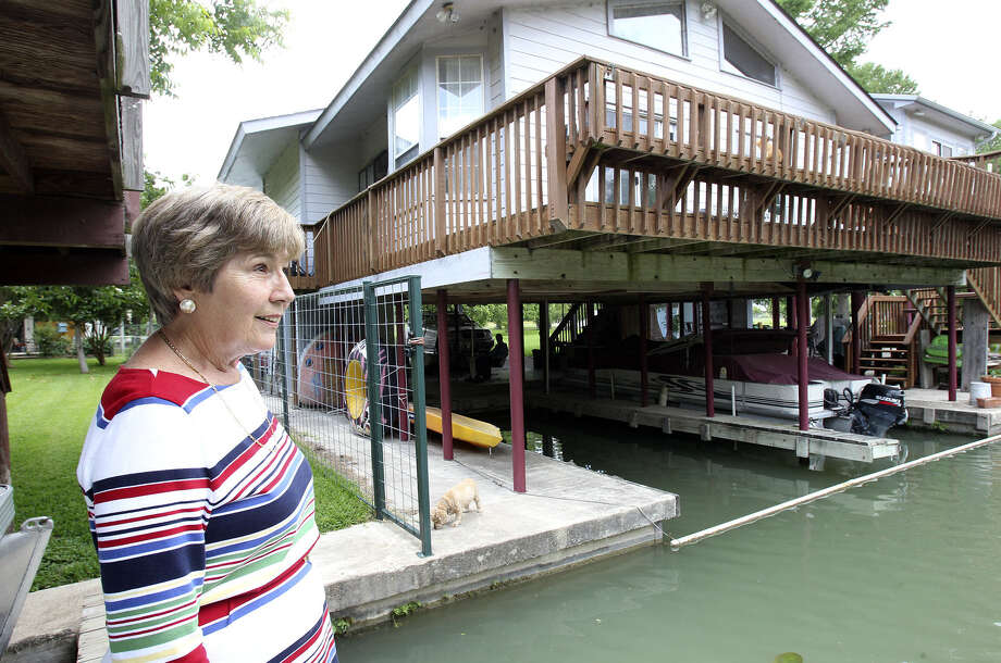 Kay Hays, 68, and her husband Steve own this home on Placid Lake in Guadalupe County. They signed up for FEMA funds. Photo: Tom Reel / San Antonio Express-News