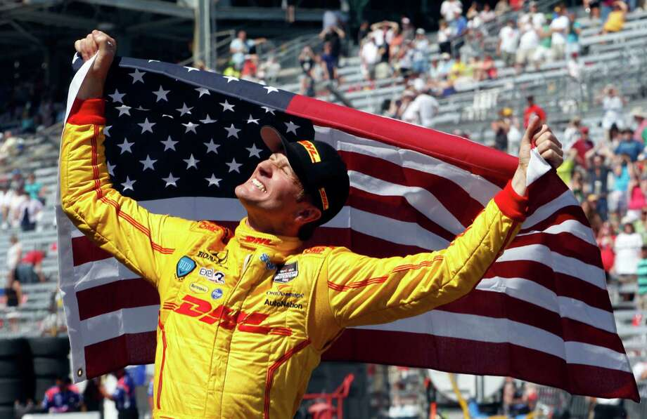Ryan Hunter-Reay celebrates after winning the 98th running of the Indianapolis 500 IndyCar auto race at the Indianapolis Motor Speedway in Indianapolis, Sunday, May 25, 2014. (AP Photo/Tom Strattman) ORG XMIT: NAA158 Photo: Tom Strattman / FR29600 AP