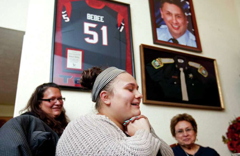 Darianne Garcia, 18, next to her mother, Ryssa, 37, left, and grandmother, Sabina Bebee, 67, shares a story about her uncle, fallen firefighter Robert Bebee, one of four to perish in a May 31, 2013, fire. Photo: Johnny Hanson / © 2014  Houston Chronicle