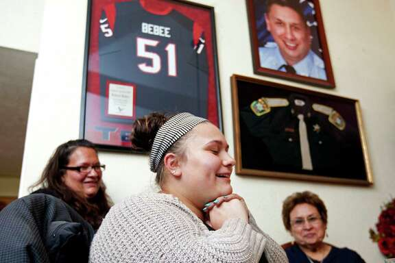 Darianne Garcia, 18, next to her mother, Ryssa, 37, left, and grandmother, Sabina Bebee, 67, shares a story about her uncle, fallen firefighter Robert Bebee, one of four to perish in a May 31, 2013, fire.