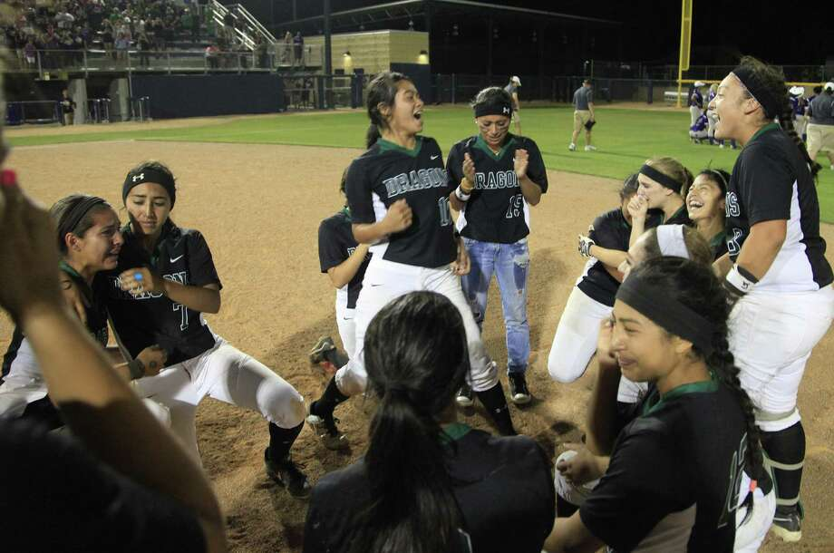 Southwest players celebrate Saturday after winning the third and deciding game in the Region IV-5A final series. The Dragons are headed to their first state tournament. Photo: J. Michael Short / For The Express-News / ©2014 J. MICHAEL SHORT;