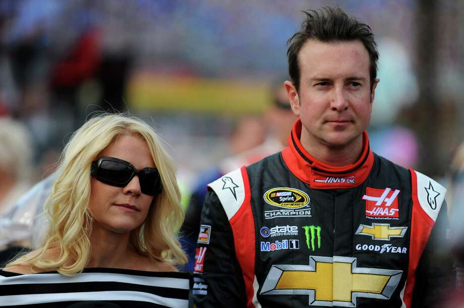 CHARLOTTE, NC - MAY 25: Kurt Busch, driver of the #41 Haas Automation Made in America Chevrolet, stands with his girlfriend, Patricia Driscoll, on the grid prior to the NASCAR Sprint Cup Series Coca-Cola 600 at Charlotte Motor Speedway on May 25, 2014 in Charlotte, North Carolina.  (Photo by Will Schneekloth/Getty Images) Photo: Will Schneekloth, Stringer / 2014 Getty Images