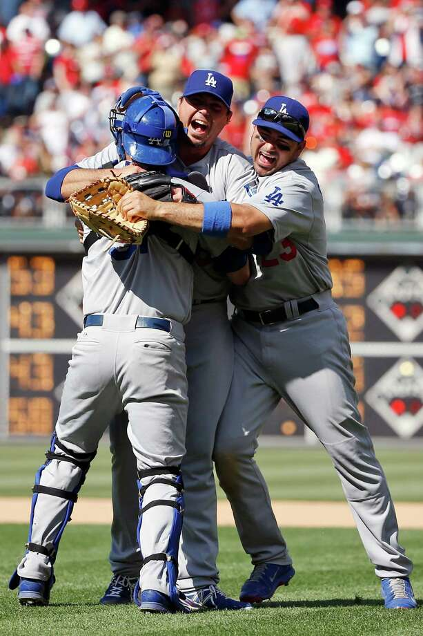 Los Angeles Dodgers starting pitcher Josh Beckett, center, celebrates with catcher Drew Butera, left, and first baseman Adrian Gonzalez after pitching a no-hitter baseball game against the Philadelphia Phillies, Sunday, May 25, 2014, in Philadelphia. Los Angeles won 6-0. Beckett pitched the first no-hitter of his career and the first in the majors this season. (AP Photo/Matt Slocum) ORG XMIT: PXS117 Photo: Matt Slocum / AP