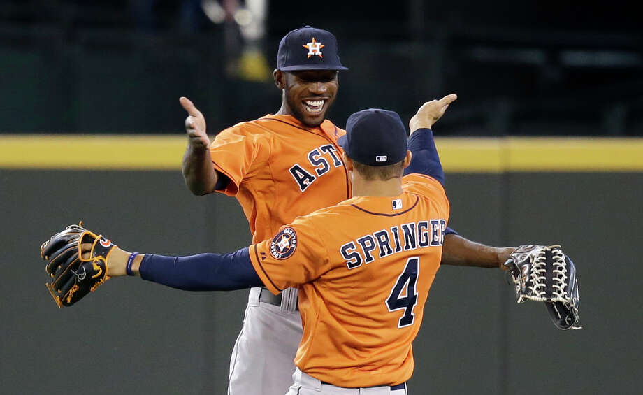 The Astros' Dexter Fowler, left, and George Springer, right, will be joined in the outfield by Robbie Grossman, who now will serve as the everyday left fielder. Photo: Elaine Thompson, STF / AP