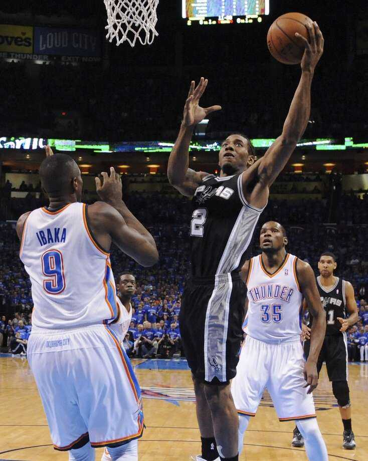 San Antonio Spurs' Kawhi Leonard shoots around Oklahoma City Thunder's Serge Ibaka during first half action in Game 3 of the Western Conference Finals Sunday May 25, 2014 at Chesapeake Energy Arena in Oklahoma City, OK. Photo: Edward A. Ornelas, San Antonio Express-News