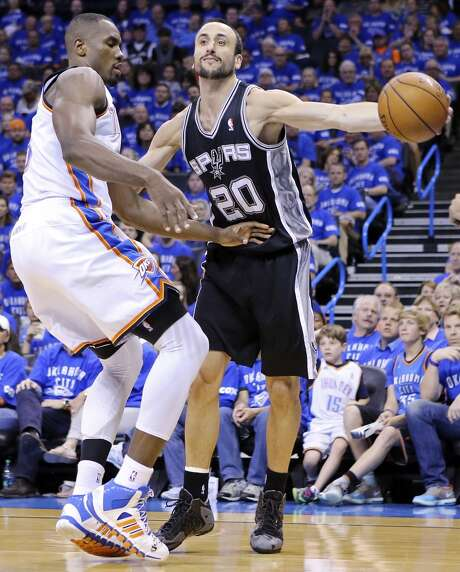 San Antonio Spurs' Manu Ginobili passes around Oklahoma City Thunder's Serge Ibaka during second half action in Game 3 of the Western Conference Finals Sunday May 25, 2014 at Chesapeake Energy Arena in Oklahoma City, OK. The Thunder won 106-97. Photo: Edward A. Ornelas, San Antonio Express-News
