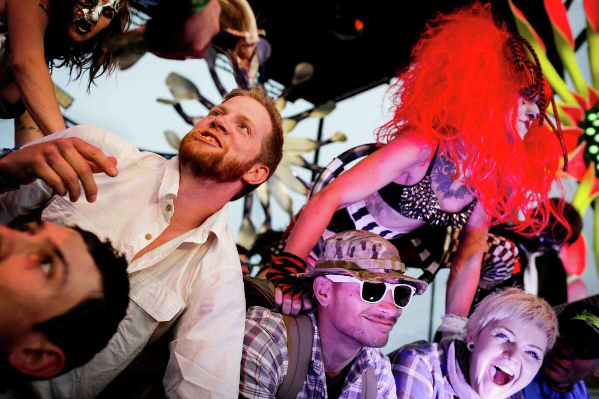 Super Geek League dancers hold down fans to the stage on the third and final day of the annual Sasquatch music festival Sunday, May 25, 2014, in George, Wash.