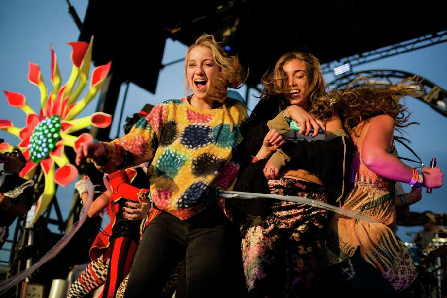 Young women dance on stage with the Super Geek League during the third and final day of the annual Sasquatch music festival Sunday, May 25, 2014, in George, Wash. Photo: JORDAN STEAD, SEATTLEPI.COM / SEATTLEPI.COM