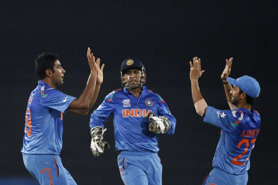 16. Mahendra Singh Dhoni (center)  Salary: $3.5 million Endorsements: $30 million  Total: $33.5 million Photo: A.M. Ahad, Associated Press