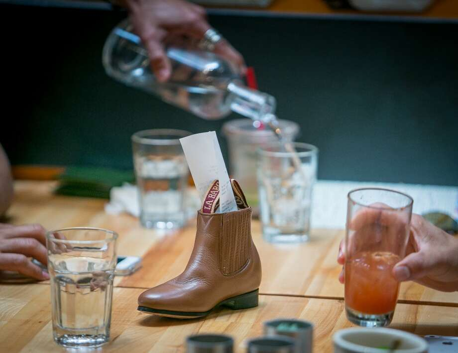 The check in a boot at Lolo in San Francisco. Photo: John Storey, Special To The Chronicle