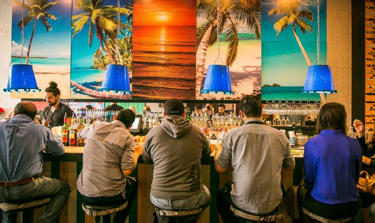 Diners enjoy lunch at the bar at Lolo in San Francisco.