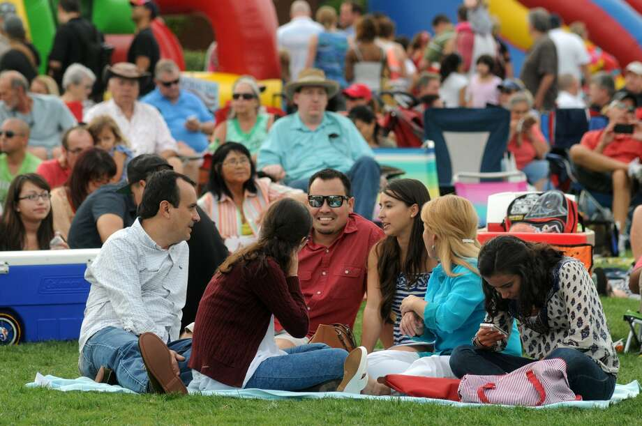Steven Ortega, center, of Houston, with his girlfriend, Priscilla Hinojosa, of The Woodlands, and her family members Enrique, from left, Mariana, Irasema, and Fatima, take in the sights and sounds while listening to The Buck Yeager Band during the Memorial Day Weekend Celebration at Town Green Park in The Woodlands on May 25th. Photo: Jerry Baker, For The Chronicle