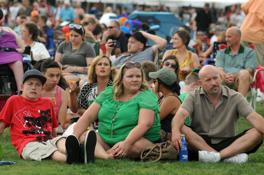 Shawn Boiles, from right, of Colorado Springs, his wife, Michelle, and their son, Brandon, 15, take in the sights and sounds while listening to The Buck Yeager Band during the Memorial Day Weekend Celebration at Town Green Park in The Woodlands on May 25th. Photo: Jerry Baker, For The Chronicle