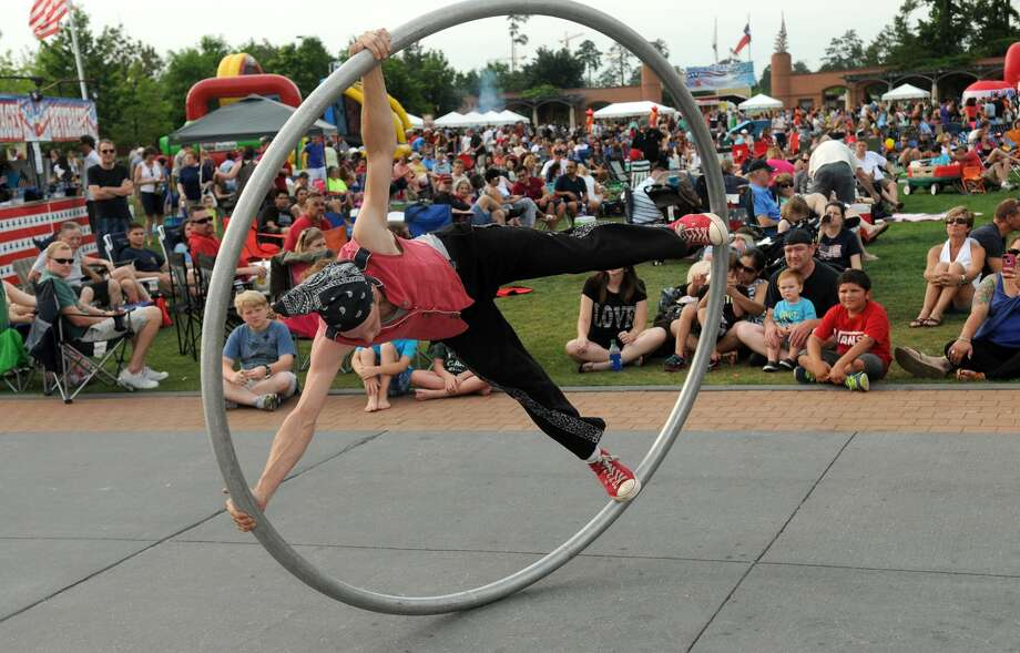 """Mr. Cirque"" (Noah Maudlin of Kemah) entertains the crowd during the Memorial Day Weekend Celebration at Town Green Park in The Woodlands on May 25th. Photo: Jerry Baker, For The Chronicle"