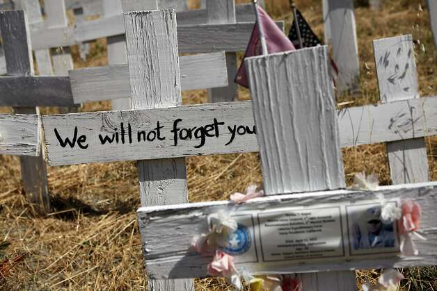 Pictures of fallen soldiers and personal messages are seen on crosses at the Crosses of Lafayette war memorial which covers a hillside next to the Lafayette BART station in Lafayette, CA, Wednesday May 21, 2014. Photo: Michael Short