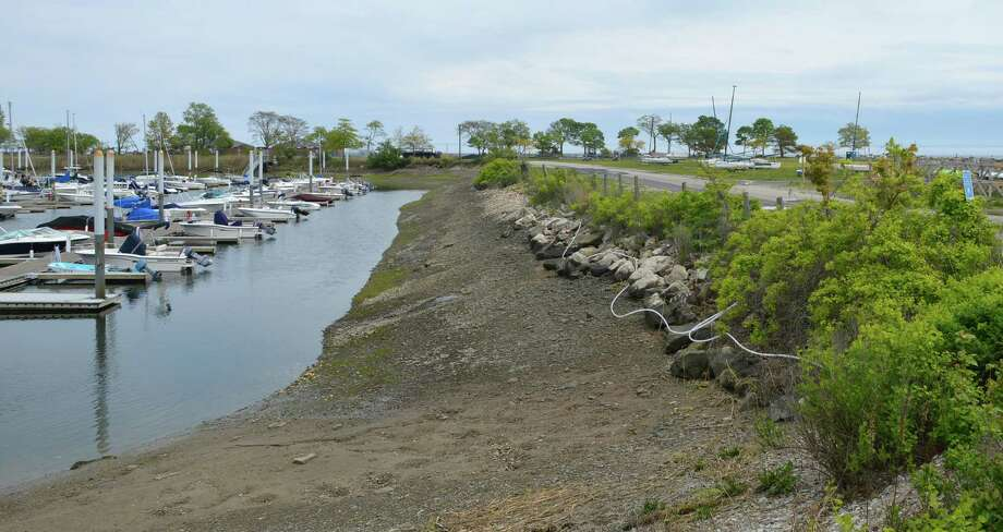 Deterioration of the shoreline along the Ned Dimes Marina needs to be repaired at a potential cost of $800,000. Photo: Jarret Liotta / Westport News