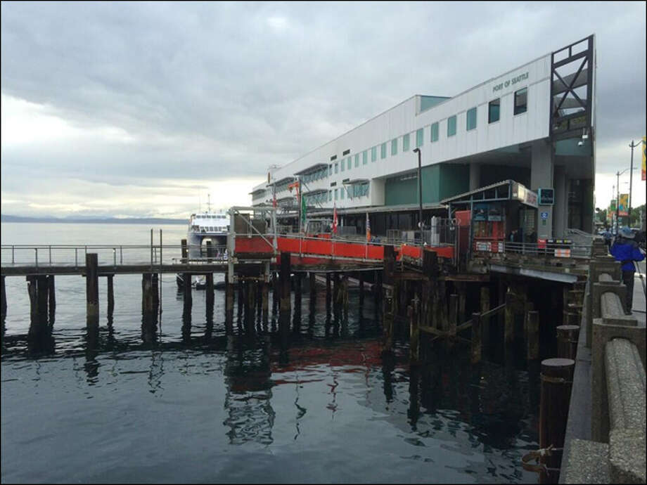Police search under Pier 69 for a possibly armed burglary suspect who fled from the balcony of a nearby apartment. Photo: KOMO TV