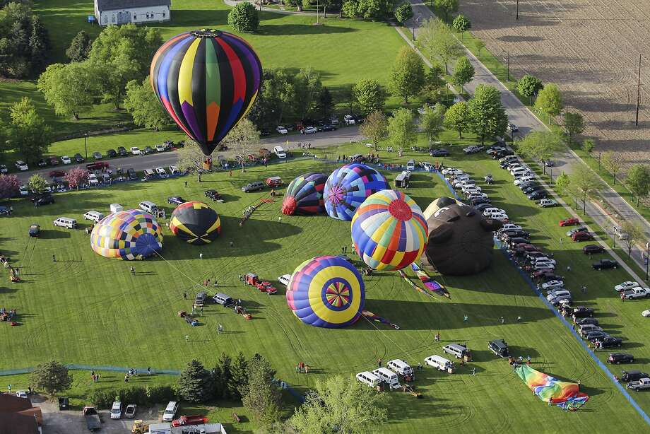 Inflationary trend: Hot-air balloons prepare to take off at River Place Field in Frankenmuth, Mich. Photo: Neil Barris, Associated Press