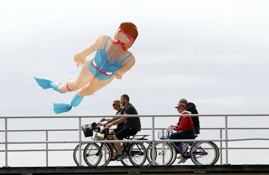 Terrible rip tides today: A snorkeler sails over cyclists on the boardwalk in Wildwood. N.J. Photo: Michael S.Wirtz, Associated Press