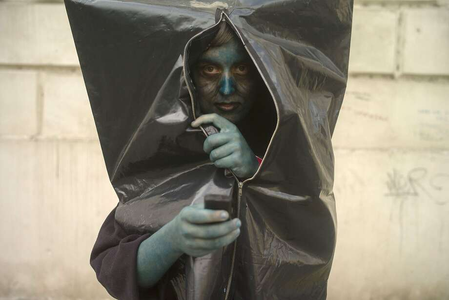 Czech inside:A body bag opens itself during the Zombie Walk in Prague. Photo: Michal Cizek, AFP/Getty Images