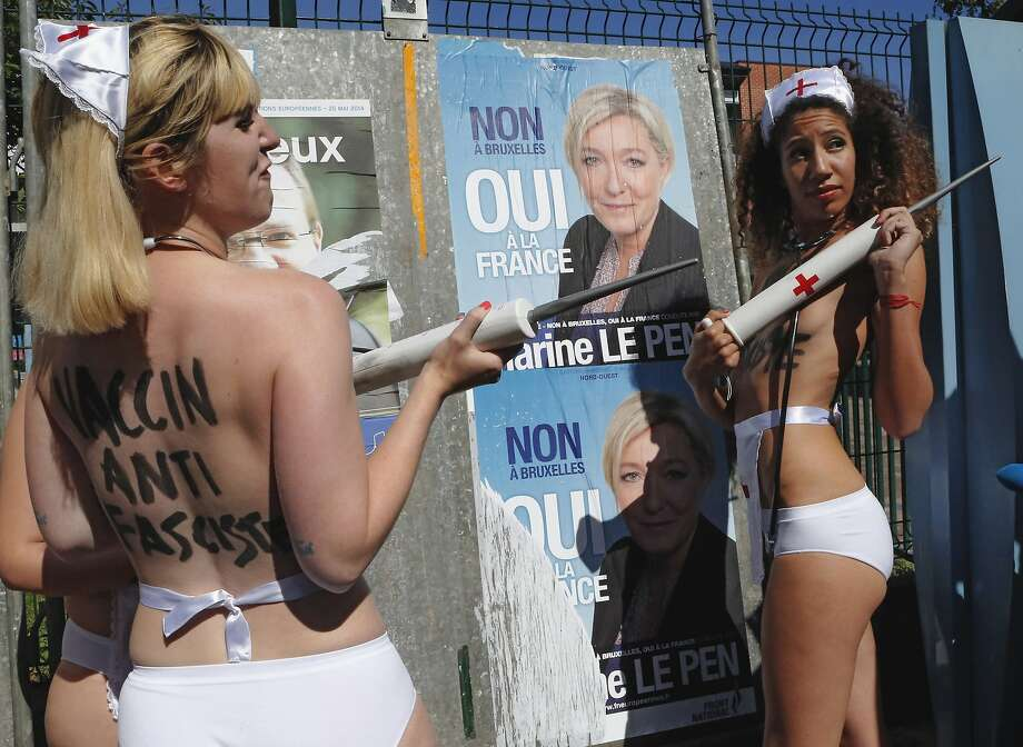 "Who wants to be inoculated? Scantily clad Femen ""nurses"" offer to vaccinate the French against fascism - personified, in their view, by French far-right leader Marine Le Pen - in Henin-Beaumont, France. Unfortunately for Femen, the vaccination program didn't catch on with voters, who handed Le Pen's National Front party an outright victory in parliament elections. Photo: Jacques Brinon, Associated Press"