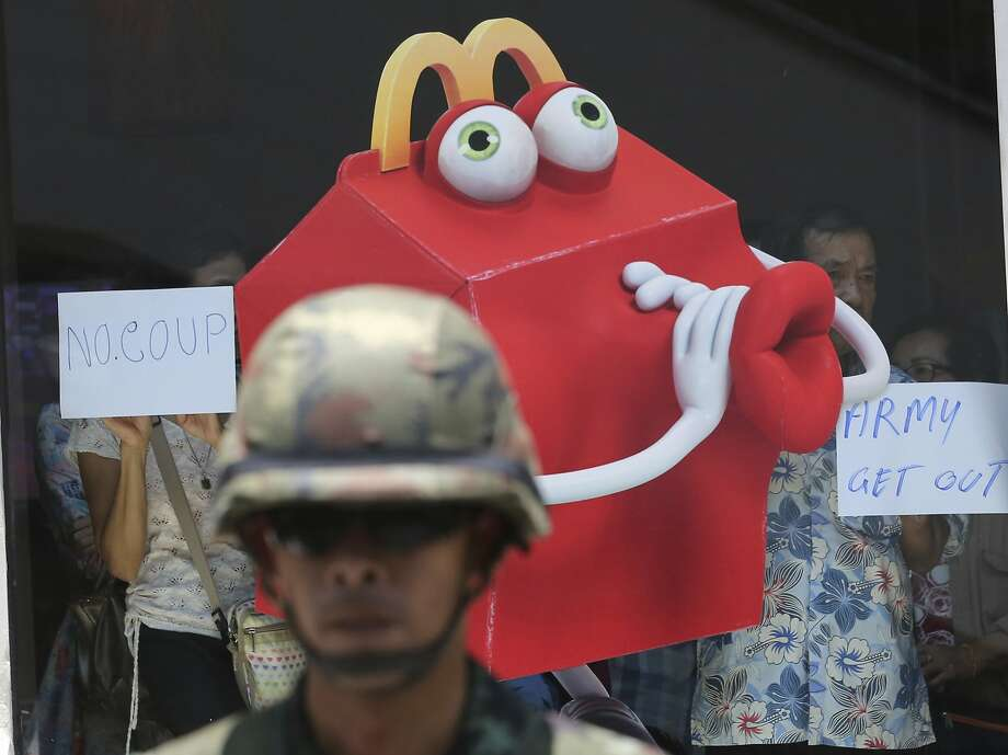 Flouting a warning by Thailand's ruling junta against street protests, McDonald's Happy Meal mascot joins an anti-coup demonstration at a shopping mall in Bangkok. Fortunately - or unfortunately depending on your point of view - he was not thrown in the pokey with the Hamburglar. Photo: Sakchai Lalit, Associated Press