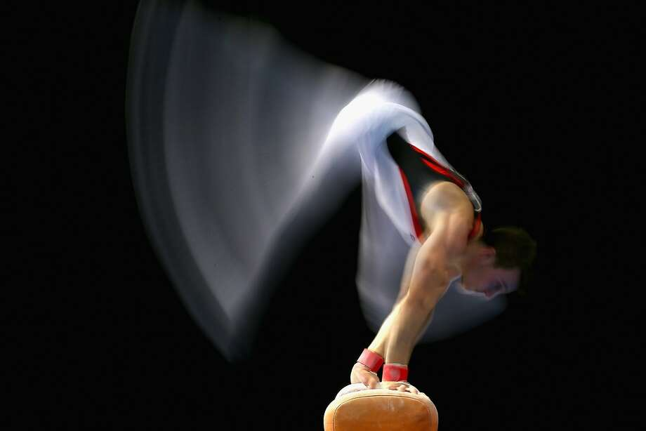 Ride 'em, pommel cowboy! Michael Mercieca performs on the pommel horse during the Australian National Gymnastics Championships in Melbourne. Photo: Quinn Rooney, Getty Images