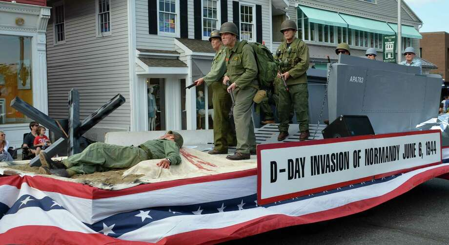 At the annual Memorial Day parade on Monday, the Ys Men won the competition for the best float with this depiction of World War II's D-Day Invasion. Photo: Jarret Liotta / Westport News