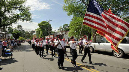 Members of the Sound Beach Volunteer Fire Department band and color guard march up Sound Beach Avenue during the Sound Beach Volunteer Fire Department's Memorial Day Parade in Greenwich, Conn., on Monday, May 26, 2014.