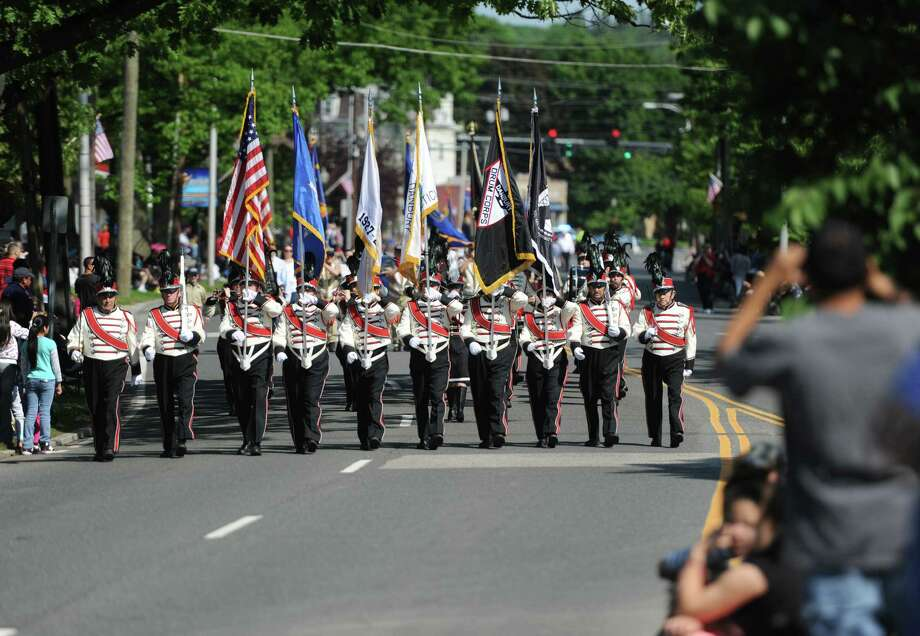 Folks watch as the start of the Memorial Day parade comes down Main Street in Danbury, Conn. Monday, May 26, 2014.  The parade began at Rose Street and Main Street, finishing at Rogers Park, where skydivers dropped onto the field at Rogers Park Middle School. The parade was followed by a memorial service at the Rogers Park Rose Memorial Garden. Photo: Tyler Sizemore / The News-Times