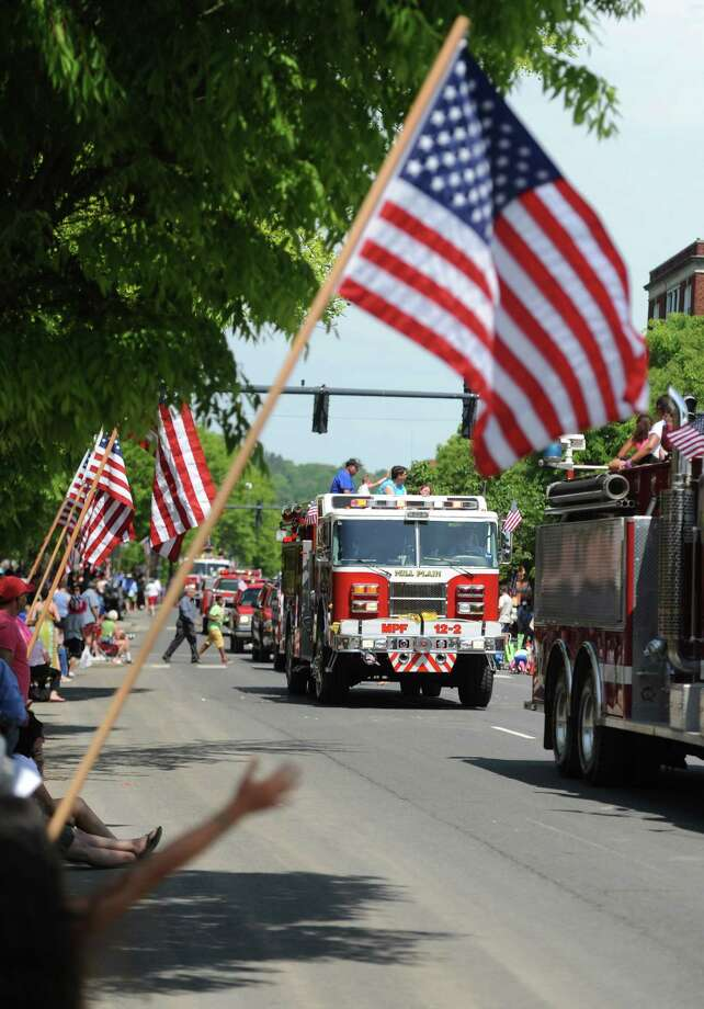Fire trucks drive down Main Street in the Memorial Day parade in Danbury, Conn. Monday, May 26, 2014.  The parade began at Rose Street and Main Street, finishing at Rogers Park, where skydivers dropped onto the field at Rogers Park Middle School. The parade was followed by a memorial service at the Rogers Park Rose Memorial Garden. Photo: Tyler Sizemore / The News-Times