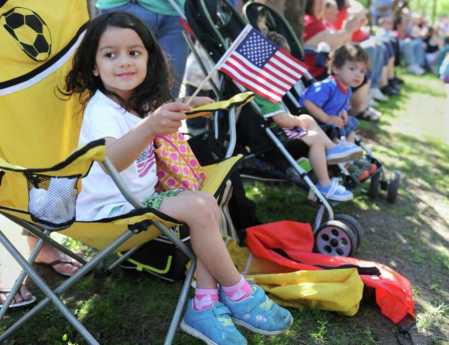 Jocelyn Cunha, 3, of Danbury, waves a flag while watching the Memorial Day parade on Main Street in Danbury, Conn. Monday, May 26, 2014.  The parade began at Rose Street and Main Street, finishing at Rogers Park, where skydivers dropped onto the field at Rogers Park Middle School. The parade was followed by a memorial service at the Rogers Park Rose Memorial Garden. Photo: Tyler Sizemore / The News-Times
