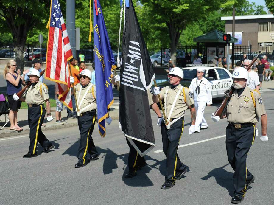 American Legion members remember the prisoners of war and those missing in action while marching in the Memorial Day parade on Main Street in Danbury, Conn. Monday, May 26, 2014.  The parade began at Rose Street and Main Street, finishing at Rogers Park, where skydivers dropped onto the field at Rogers Park Middle School. The parade was followed by a memorial service at the Rogers Park Rose Memorial Garden. Photo: Tyler Sizemore / The News-Times