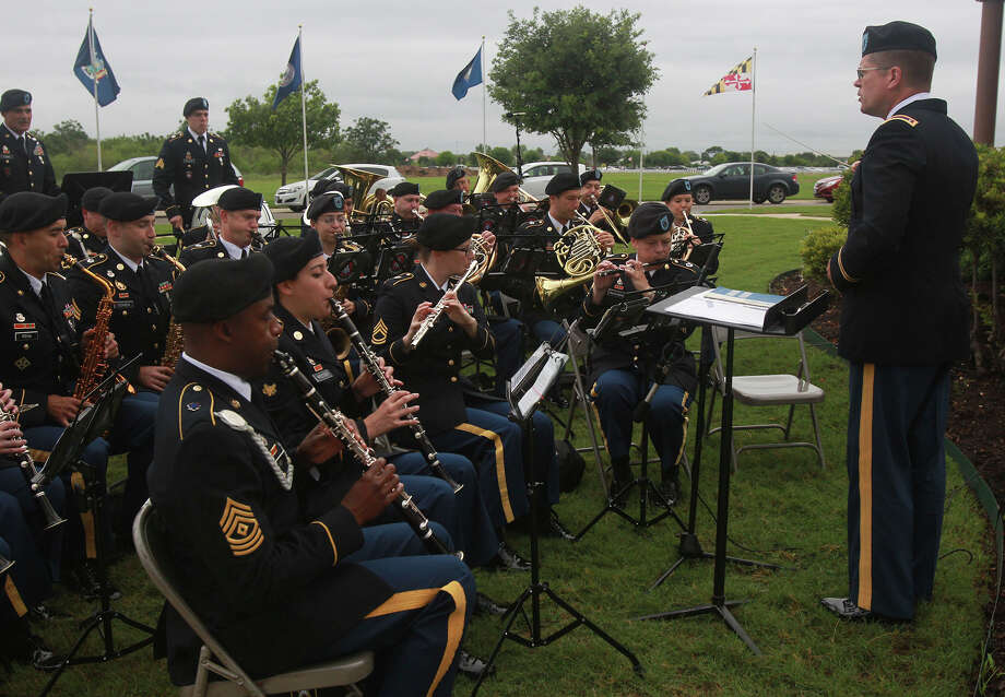 "The 323D Army Band, also known as ""Fort Sam's Own,"" plays for the crowd Memorial Day Monday May 26, 2014 at Fort Sam Houston National Cemetery. Photo: JOHN DAVENPORT, San Antonio Express-News / ©San Antonio Express-News/John Davenport"