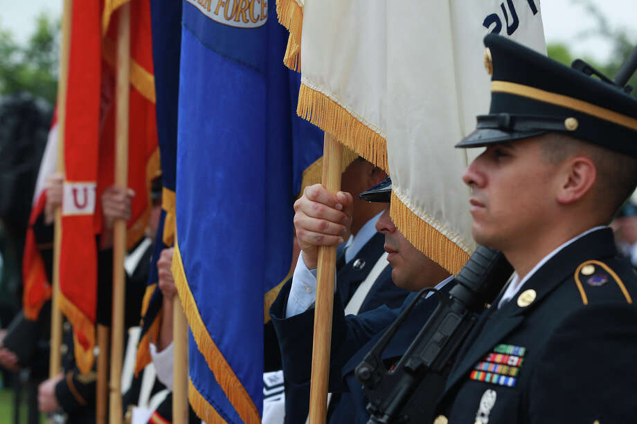 The color guard stands at attention Monday May 26, 2014 at a Memorial Day ceremony at Ft. Sam Houston National Cemetery. Photo: JOHN DAVENPORT, San Antonio Express-News / ©San Antonio Express-News/John Davenport