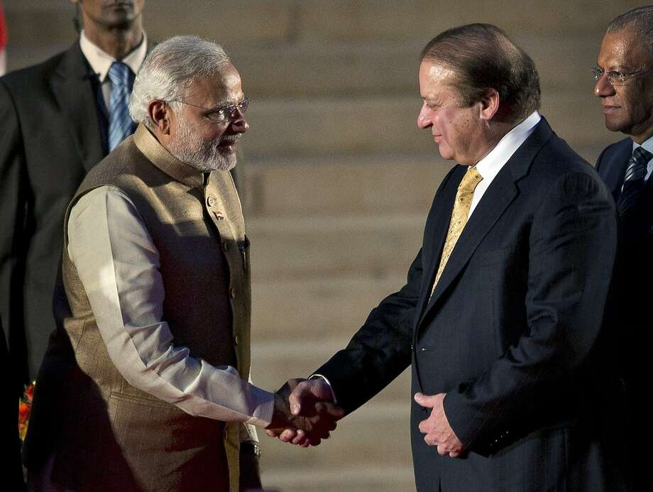 New Indian Prime Minister Narendra Modi (left) invited Pakistan's Nawaz Sharif to the ceremony. Photo: Manish Swarup, Associated Press