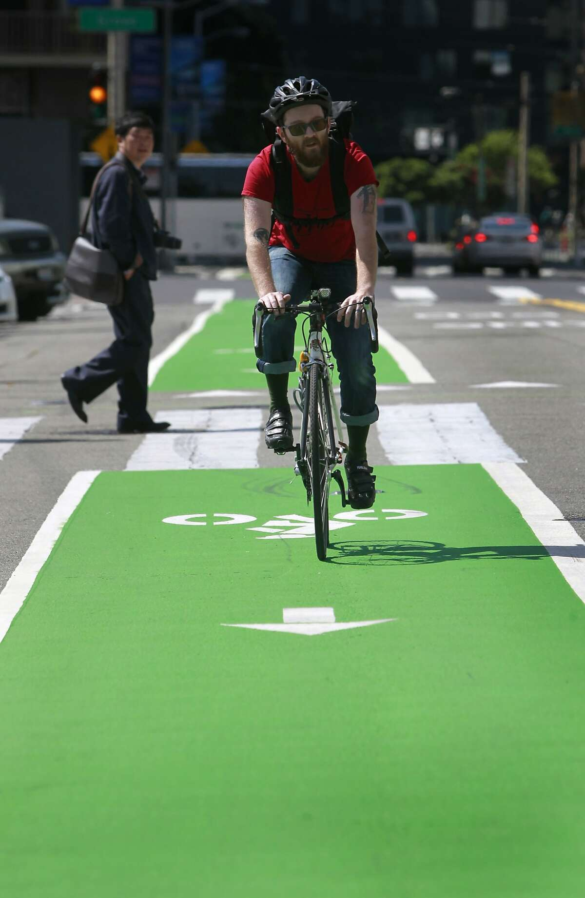 Jared Shoupe rides his bicycle on the new Polk Street bicycle lane past City Hall in San Francisco, Calif. on Saturday, May 24, 2014.