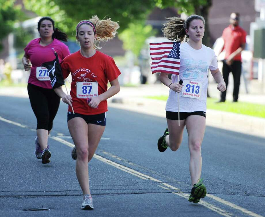 Photos from the Memorial Day 5K, presented by CityCenter Danbury and the Danbury Police Department, in Danbury, Conn. Monday, May 26, 2014.  The race was run along the parade route just before the parade to benefit Building Homes for Heroes, a charity to help severely wounded and disabled veterans returning from Iraq and Afghanistan build homes for their families and rebuild their lives.  Finishing first overall was Aaron Mendelsohn, of New York, N.Y., with a time of 16:46, and the first female finisher was Kristina Braun, of Danbury, with a time of 21:20. Photo: Tyler Sizemore / The News-Times